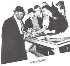 Students clamor for an autograph from star of stage & screen Paul Robeson at Mac Court after his concert in 1941.  From the 1941 Oregana (University of Oregon yearbook).  www.CampusAttic.com