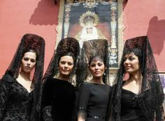 Ladies with a Mantilla and a high comb, named la Peineta, on their heads.