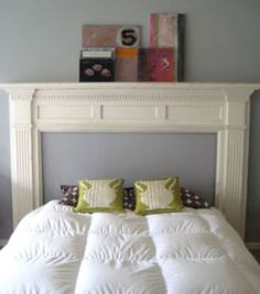 Old mantel refinished for headboard -- would look really great with fabric in the fireplace space.