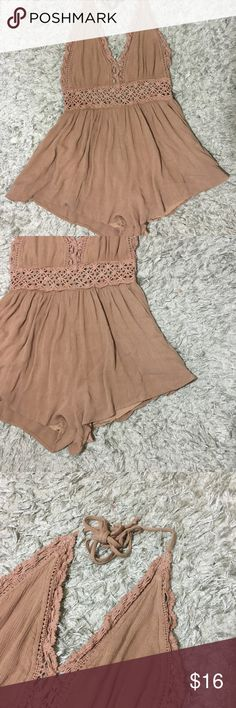 """Nude brown one piece Romper halter crochet size s Brown Romper  Loose shorts and halter top  Invisible zipper in back  Size Small  Waist: 13.5"""" -------  DISCLAIMER:: Color may vary slightly depending on computer screen and fluorescent lighting. Photos were taken in natural light under shaded condition. Comes from smoke free/ pet free home. Please review my feedback and feel free to ask any questions.  Descriptions are written as honest possible and photos assist the full description. Cotton…"""