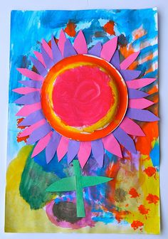 Painted background first. Painted a paper plate for the center. Looked at real sunflowers for inspiration of how the petals overlapped...Created a flower of our dreams!