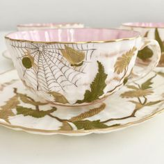 Three Ott & Brewer American Belleek eggshell teacups with flowers and insects, 1880s