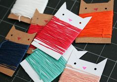 Got a few minutes and some cardboard to spare? Then you can make these adorable thread keepers. Meow. #DIY