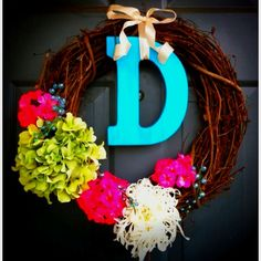 Such a cute wreath! Do a neutral color letter and interchange the flowers for different occasions.