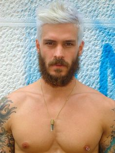 Only had he shave he would've been a hottie! >.< White hair, Brown beard ?