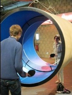 Tube tennis or circular ping pong cool. I have a ping pong table but not like this! Backyard Games, Outdoor Games, Backyard Ideas, Jouer Au Tennis, Cool Inventions, Experiential, Ping Pong Table, Architecture, Home Decor