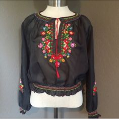 "Handmade Hungarian Vintage Top Beautifully embroidered top from Hungary. Authentic and hand made. 100% polyester. Versatile for many looks. Great with dark wash jeans and a leather jacket or with a full Hungarian look with the full skirt. Fits in perfectly with the recent ""festival hippy"" look. Runs a little small. Handmade Tops Blouses"