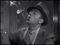 """William Powell blows suave smoke rings in """"The Thin Man"""" (1934)"""