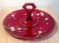 A personal favorite from my Etsy shop https://www.etsy.com/listing/257690104/vintage-round-red-glass-wcenter-handle