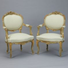 "Pair Gilded Louis XV Style Fauteuils --- These circa 1870s chairs have painted and gilded frames, oval seat backs, padded arms and new upholstery. Beautifully detailed. Matching settee sold separately. Sold and priced as a pair. ---  Arm Height:  25.5""   -  Seat Height:  18.25"" ---  Seat Depth:  18.5"" --- Item: 3407 Retail Price:  $3495"