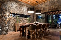 I like the lighting, the wall texture and the idea of bar type seating in front of a large sliding door opening on a warm summer's night Interior Modern, Interior And Exterior, Interior Design, Style At Home, Stone Houses, Modern Rustic, Rustic Chic, Cabana, My Dream Home
