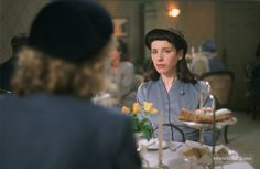 Vera Drake 2004-Sally Hawkins as Susan Wells the daughter of one of Vera's housecleaning clients has tea with a friend.