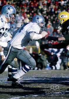 Dallas Cowboys defensive end Bob Lilly (74) in action against the Green Bay Packers during the 1967 NFL Championship game at Lambeau Field. The game was deemed the Ice Bowl as the temperature was recorded at -13f and a wind chill at -48f the coldest in NFL history. The Packers defeated the Cowboys 21-17.