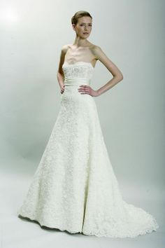 Ivory re-embroidered lace strapless corset gown with A-line skirt and cummerbund accent at waist.