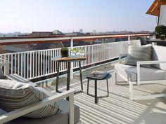 Zona de estar y comedor en la terraza