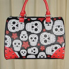 Stars and Skulls Handbag:This is a black satchel handbag with a sugar skulls and stars design on one side and solid black on the other. All four bottom corners are red and the front has a stud detail, and there's a removable shoulder strap too. It closes with a top zipper, and the inside is lined in bright red, so it's not like... $48.00