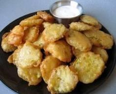 Fried Pickles:2 cups flour  1/4 teaspoon pepper  2 eggs  1 cup milk  3 cups thin dill pickle slices, drained  Oil   In a shallow bowl, combine the flour and pepper. In another bowl, beat eggs and milk. Blot pickles with paper towels to remove moisture. Coat pickles with flour, then dip in egg mixture; coat again with flour.   Heat oil to 375°. Fry pickles, about 10 at a time, for 3 minutes or until golden brown, turning once. Drain on paper towels. Serve warm with ranch dressing if desired.