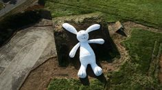 Moonrabbit by Florentijn Hofman, Taoyuan (TW) 2014. The sculpture features a rabbit relaxing on a retired aircraft hangar in the breeze and thinking about its future and dreams.