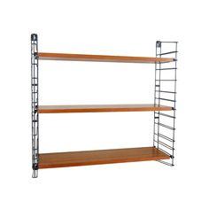 Designed by A. Dekker, for Tomado, the Netherlands. Three shelves and two ladders, enamelled metal and teakwood veneered shelves. Origination: the Netherlands, ca. 1950s