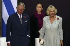 Prince Charles of Wales (L) and his wife Camilla (R), Duchess of Cornwall, pose after a speech at the National Palace during a meeting with Mexican President Enrique Pena Nieto (out of frame), in Mexico City, on November 3, 2014.