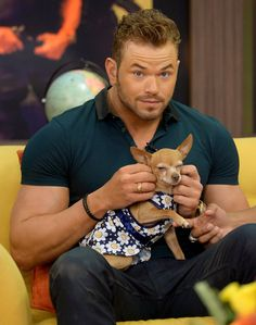 Pin for Later: Can't-Miss Celebrity Pics!  Kellan Lutz cuddle with an itty-bitty dog on Wednesday, while he was on the Miami set of Despierta America.