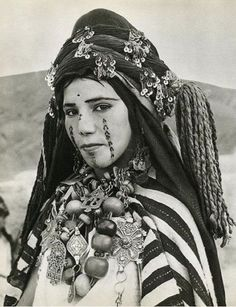 """""""""""Traditional facial tattoos run down the cheeks and chin of this Berber woman, photo ~ early 1950's."""" """""""