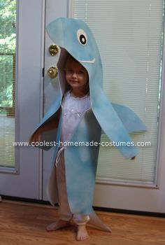 Dolphin / Shark Costume - foam, glue, spray paint. For parade just do headpiece and dress in grey or blue.