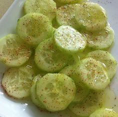 Sliced cucumbers with lemon juice, a little olive oil, sea salt, pepper & chili powder