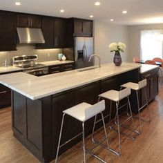 Love the island with the different levels. contemporary kitchen by Drawing Dept