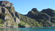 The rock faces that surround Whangaroa Harbour.