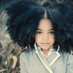 She's a lil Stunner....the hair tho!!!