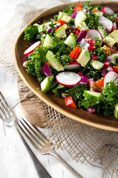 [ Recipe: My Go To Kale Salad ] Using kale, hemp (flax or avocado oil), fresh lemon juice, pure maple syrup, Herbamare (or sea salt), cayenne pepper, radish, avocado, cucumber, red pepper, celery, red onion, pomegranate seeds, and hemp seeds. ~ from OhSheGlows.com