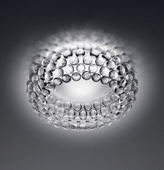 The NEW Caboche ceiling lamp by Foscarini is designed by Patricia Urquiola and Eliana Gerotto in This spectacular light is composed by transparent globes made of polymethylmetacrylate. A shade in white matt finish glass offers direct upward . Flush Ceiling Lights, Flush Mount Lighting, Flush Mount Ceiling, Sconce Lighting, Ceiling Lighting, Ceiling Lamps, Patricia Urquiola, Lampe Applique, Crystals