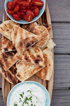 Grilled Garlic Flatbread: 2-3 cloves garlic, minced or pressed  1¼ tsp. salt  2 tsp. sugar  2 tsp. instant (rapid rise) yeast  2 tbsp. olive oil  ¾ cup (6 oz.) water, at room temperature  2 cups (8½ oz.) unbleached all-purpose flour  1 cup (5 7/8 oz.) semolina  1 tbsp. nonfat dry milk  ½ tsp. garlic powder