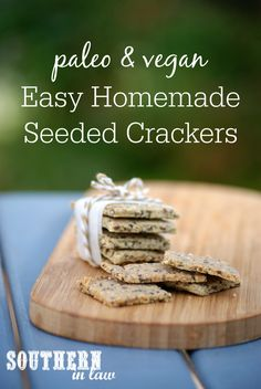 This Homemade Paleo Seeded Crackers Recipe is so simple and easy to make and made without any eggs. A gluten free, vegan, grain free, low carb, dairy free, egg free, clean eating recipe with nut free options. Made with almonds, chia seeds, flaxseed, sunflower seeds, pepitas, coconut oil and a heap of nutrient packed ingredients.