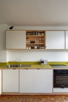 ikea kitchen cabinets with bespoke birch plywood doors and drawer