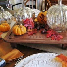 thanksgiving tablescape mercury glass pumpkins and vintage wood, home decor, seasonal holiday decor, thanksgiving decorations, A vintage serving board serves as the centerpiece of the Pottery Barn inspired tablescape