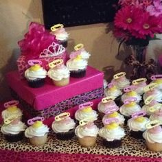 Pink leopard twin baby shower cupcakes.
