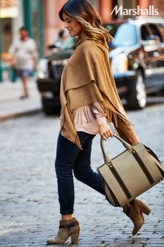 Fashion forward. Layer a blush blouse and a camel poncho for a comfy fall palette. Belted suede booties and a structured bag add detail that will keep you one step ahead.