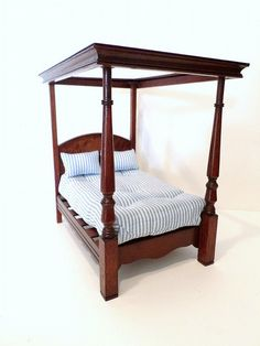 "Dennis Jenvey Regency bed. Mahogany canopy bed with attractive turned foot posts and banded burled walnut headboard with tufted mattress and two pillows. 7"" H, 7"" L, 5"" W."