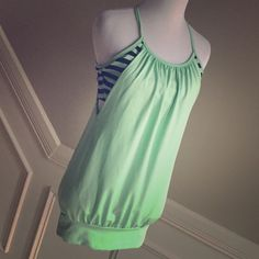 Boutique Workout Tank with Built in Bra Size S This is a workout tank from a boutique in mint green and black. It is the same style as the Lululemon No Limts Tank (this is not Lululemon). It has the built in bra and is banded at the bottom. Gorgeous color and is a size Small. Excellent condition! Remember you can save $$$ on items and shipping when you bundle items. Tops Tank Tops