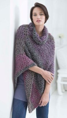 Stay warm and toasty this winter with this Cozy Cowl Poncho. Use Lion Brand yarn to work up this easy crochet poncho pattern. The cowl neckline makes this one of the most trendy crochet poncho patterns ever. #BulkyYarnCrochetPatterns