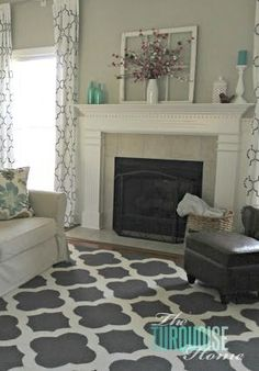 Beautiful DIY board and batten, warm wood and pops of turquoise | Living Room Makeover: Final Reveal | TheTurquoiseHome.com