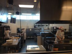 Picture of students working away in the kitchen - at Metro State University - Hospitality school.