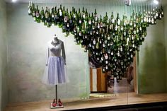 Holiday Windows NYC - Best Christmas Displays - Love the idea of using wine bottles as decorating raw materials. I'd enjoy the drinking leading up to the displaying! Christmas Window Display, Window Display Design, Store Window Displays, Christmas Displays, Retail Displays, Shop Displays, Christmas Decorations, Anthropologie Display, Anthropologie Christmas
