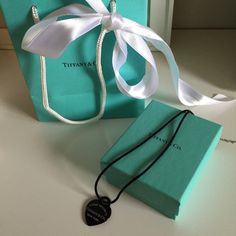 Limited Addition Black Return To Tiffany Necklace * From my personal closet * Brand new never been worn Tiffany necklace. Limited addition, not sold in stores anymore- black titanium silk string heart necklace. Comes with Tiffany bag, ribbon and padded box. Retailed for $425 in Southern California Tiffanys. Please DO NOT LOWBALL & I DO NOT TRADE Tiffany & Co. Jewelry Necklaces