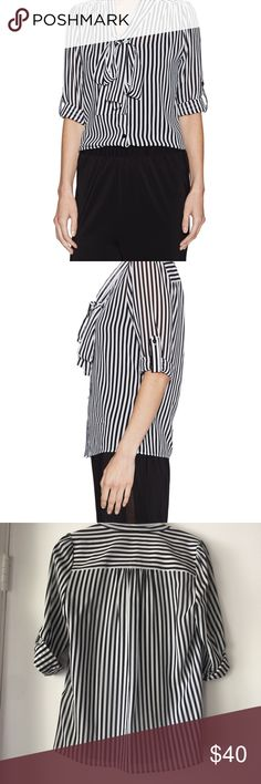 Alice + Olivia Arie Silk Tie Neck Blouse by Alice + Olivia. Sleeves roll up and are held by button. Looks great tucked in or out. Can tie bow, knot or leave loose under a fitted blazer. Alice + Olivia Tops Blouses