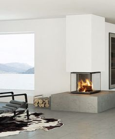 Design wall-mounted fireplace (wood-burning closed hearth ) - PREMIUM LINE - CUBEO - Rüegg Cheminées