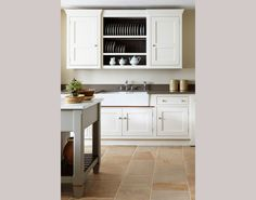 Love the floating cabinet, simply beautiful.  The white dishes really pop against the black interior of the shelves.