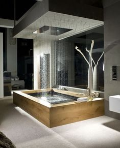 Rain shower and wooden bath, perfect! #bathroomdecorideas #bathroomsets